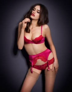 Was £95 Now £50 Stunning fuchsia silk satin is delicately adorned with bespoke hot red lace. Elegant and classic, this deep suspender  was designed with the true lingerie connoisseur in mind. Complete with a pair of Agent Provocateur stockings to finish off the look